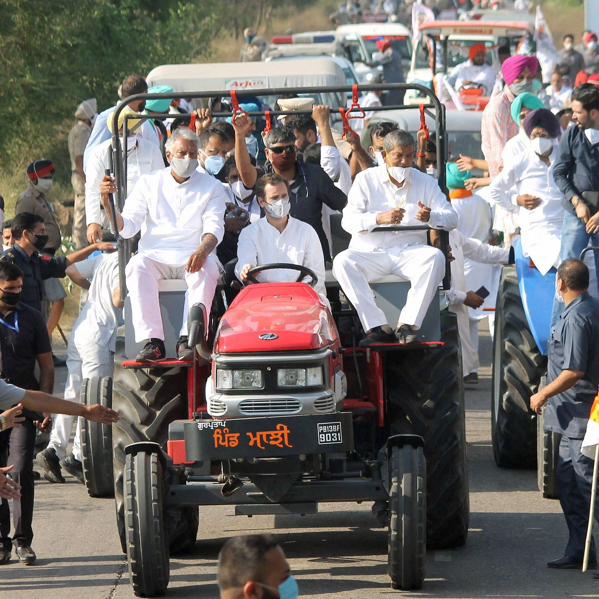 Rahul Gandhi drives a tractor, Twitter wonders if he has a licence