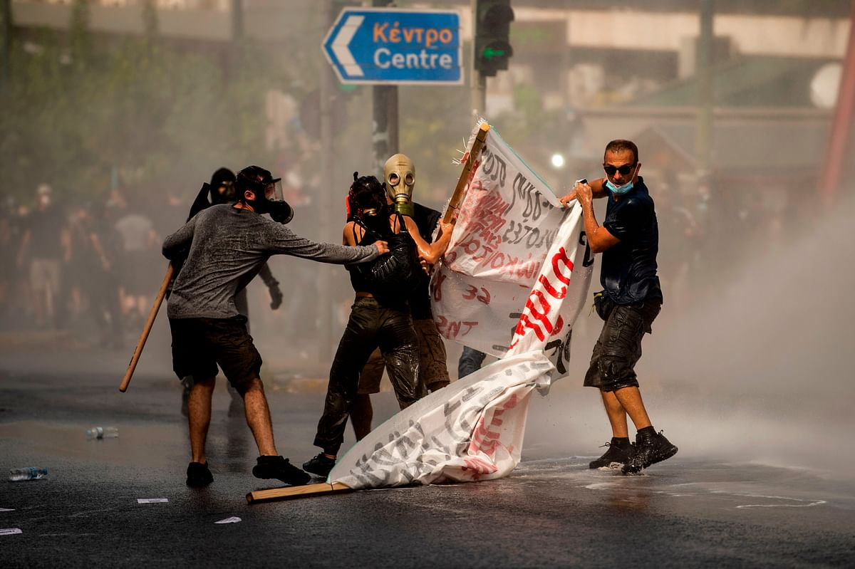 Police use water cannon during a protest in Athens.