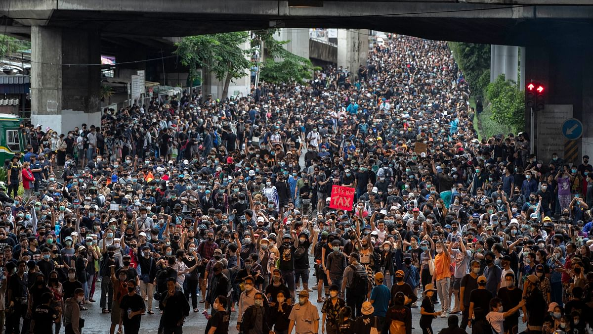 Pro-democracy protesters march during a protest in Udom Suk, suburbs of Bangkok, Thailand, Saturday, Oct. 17, 2020