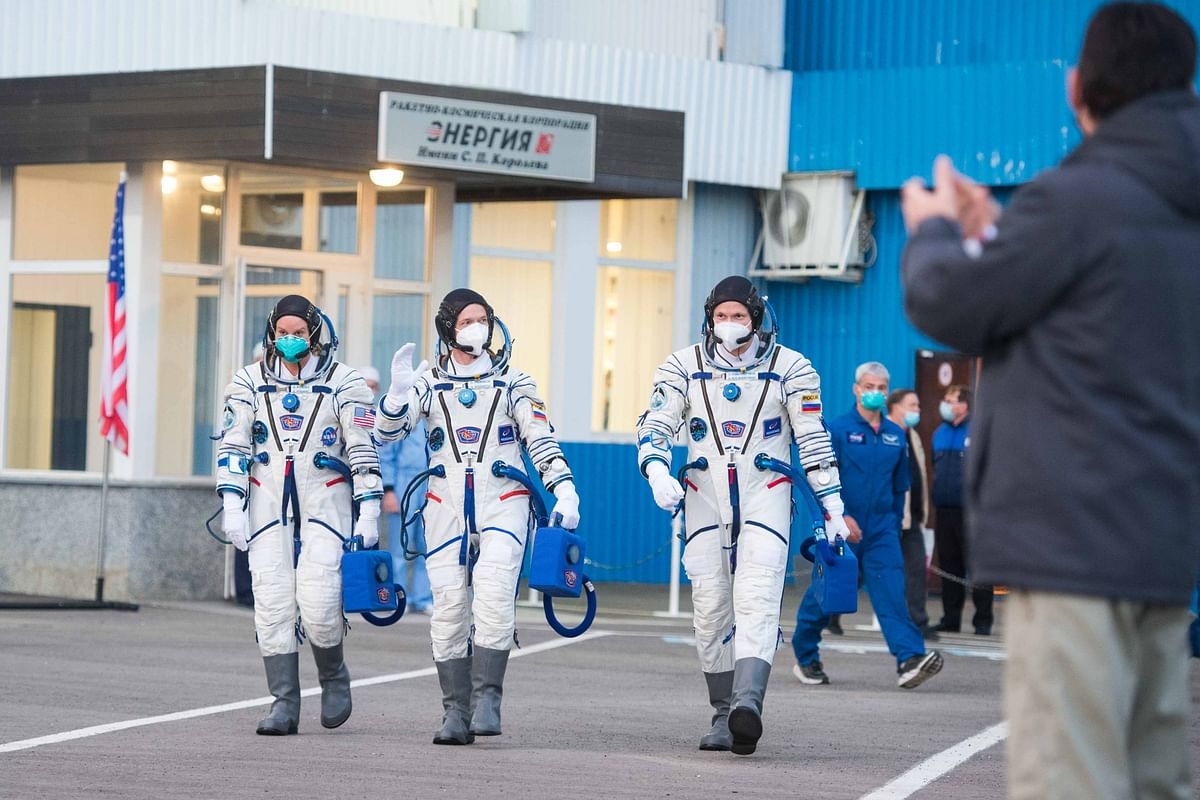 NASA astronaut Kate Rubins and Russian cosmonauts Sergey Ryzhikov and Sergey Kud-Sverchkov, members of the International Space Station (ISS) expedition 64, walk to board the Soyuz MS-17 spacecraft prior to the launch from the Russian-leased Baikonur cosmodrome in Kazakhstan.