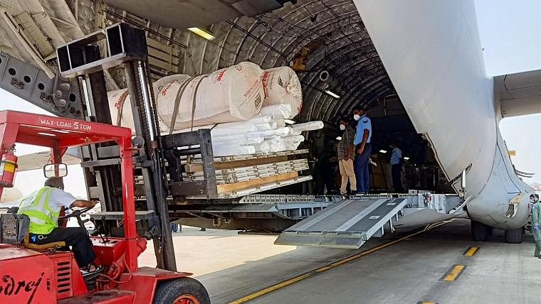 An IAF C-17 Globemaster-III aircraft being loaded with essential medical supplies to be airlifted to various parts of the country as part of IAF's assistance to the civil administration to fight against spread of Covid-19