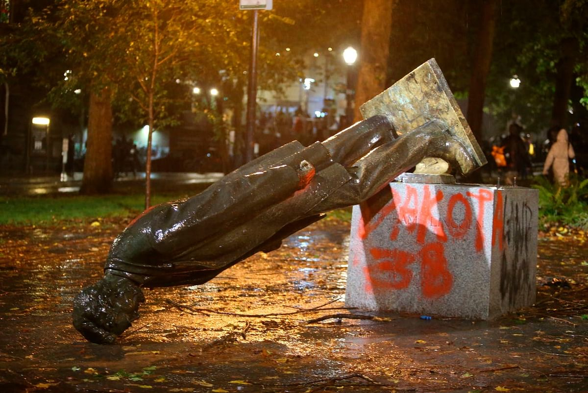Protesters knock down Roosevelt, Lincoln statues in Portland.