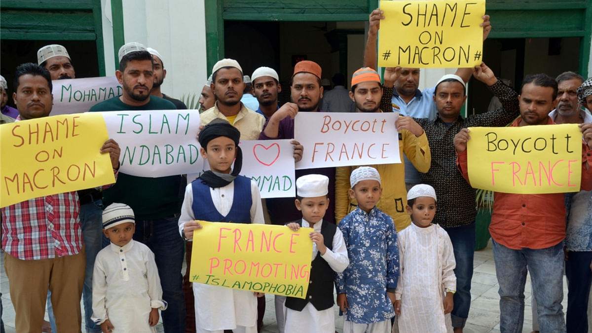 Members of the Muslim community stage a demonstration urging people to boycott France in Amritsar