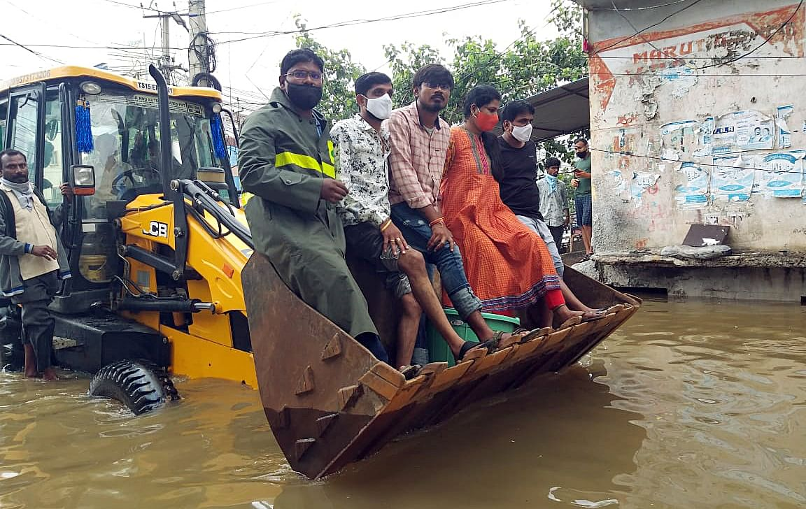 Rescue measures taking place in the Singareni colony of Santhoshnagar circle following heavy rainfall, in Hyderabad on Wednesday