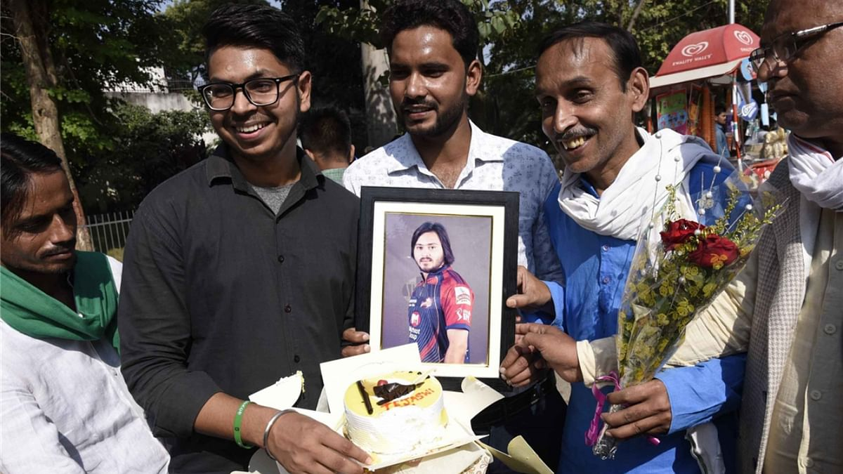 Patna: A day ahead of the counting of votes polled in the three-phase Bihar Assembly elections, supporters of Rashtriya Janata Dal leader Tejashwi Yadav assemble at Rabri Devi''s official residence at 10, Circular Road in Bihar capital Patna, carrying flowers, balloons, and garlands to wish Tejashwi