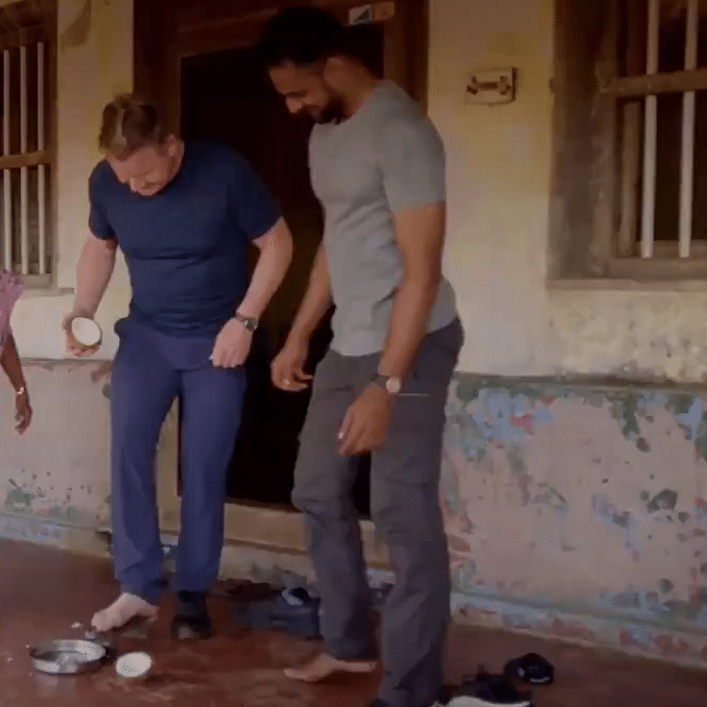 'Like the most awkward yoga pose ever...': Chef Gordon Ramsey's attempts to grate coconut with his feet will leave you chuckling