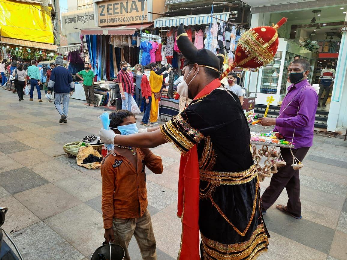 Bhopal: Yamaraj, Chitragupta urge people to wear masks