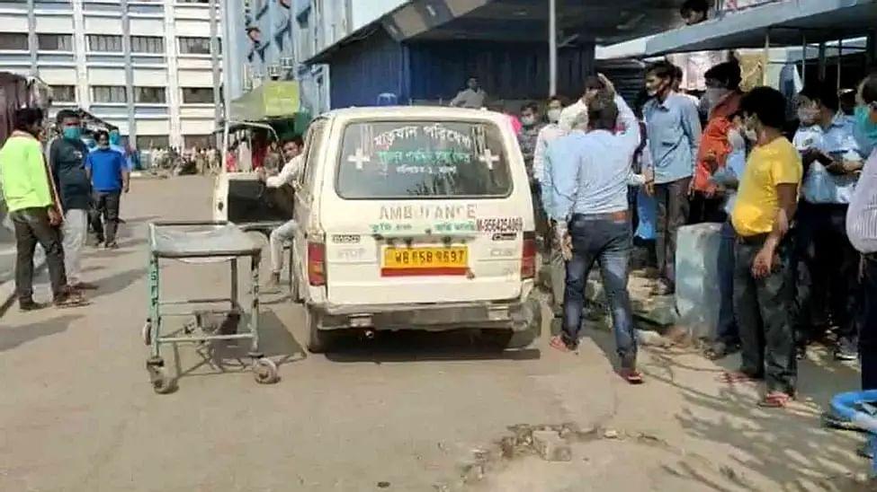 An ambulance carrying a blast victim arrives at Malda hospital