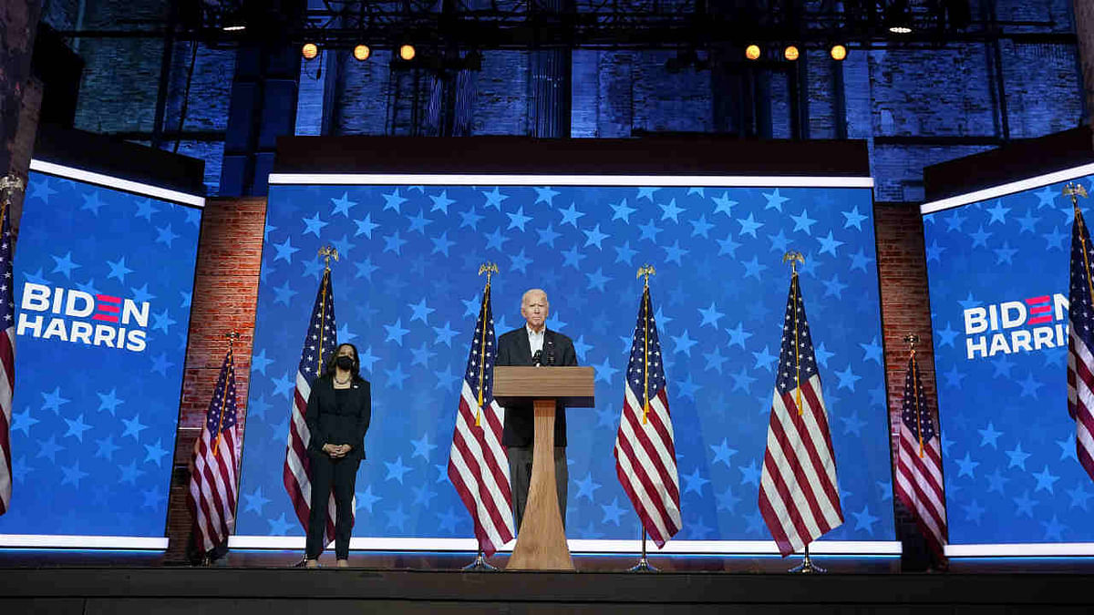 Democratic presidential nominee Joe Biden speaks while flanked by vice presidential nominee, Sen. Kamala Harris (D-CA), at The Queen theater on November 05, 2020 in Wilmington, Delaware