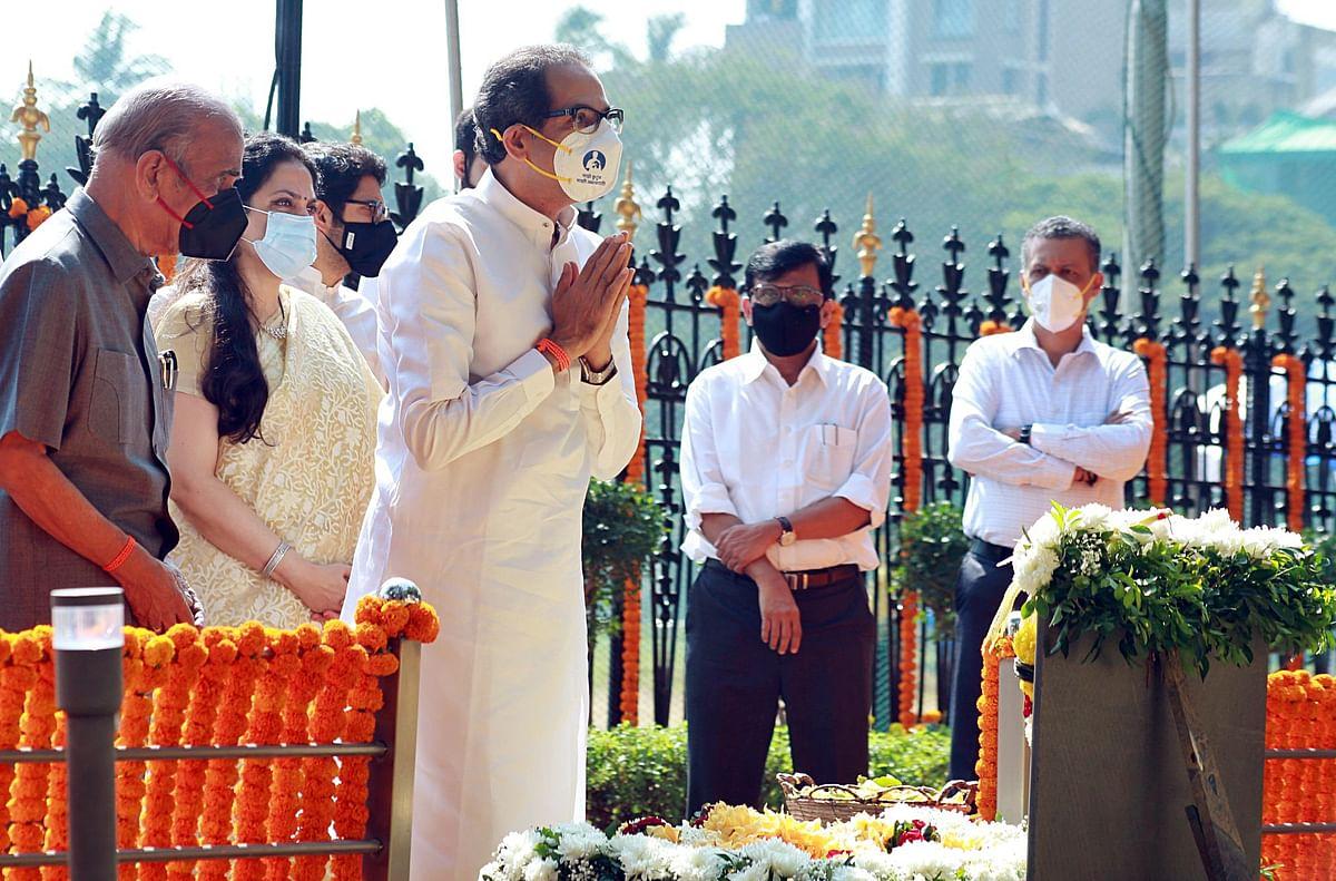 Maharashtra CM and son of BalasahebThackeray, Uddhav Thackeray along with his wife Rashmi Thackeray pay tribute to him at his memorial on his death anniversary, at Shivaji Park in Mumbai on Tuesday.