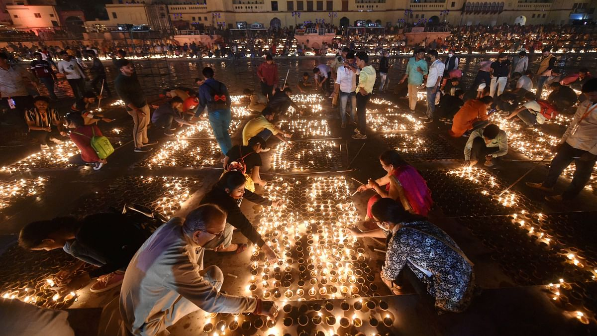 Ayodhya: Devotees light earthen lamps on the bank of Saryu River during Deepotsav celebrations in Ayodhya, Friday, Nov. 13, 2020
