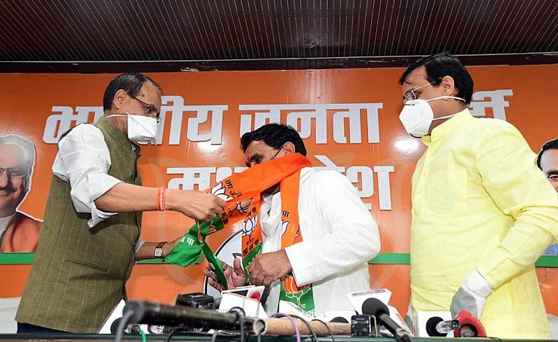 Congress MLAs Narayan Patel joins BJP in presence of Madhya Pradesh Chief Minister Shivraj Singh Chouhan and party State President VD Sharma at partys State headquarters in Bhopal on July 23.
