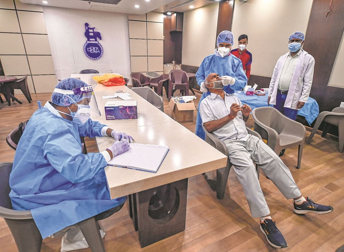 Covid cases continue to slide in India, recovery up