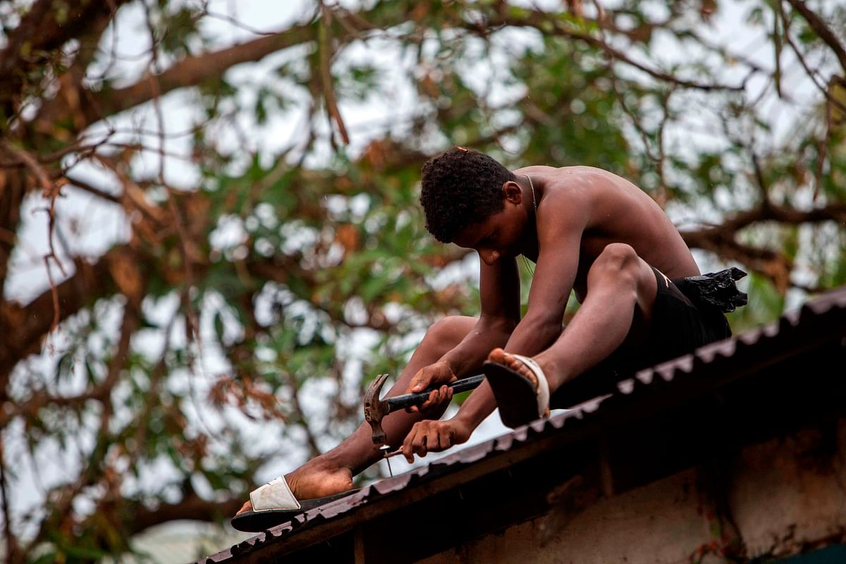 A man prepares the roof of his house for the arrival of Hurricane Iota in Nicaragua.