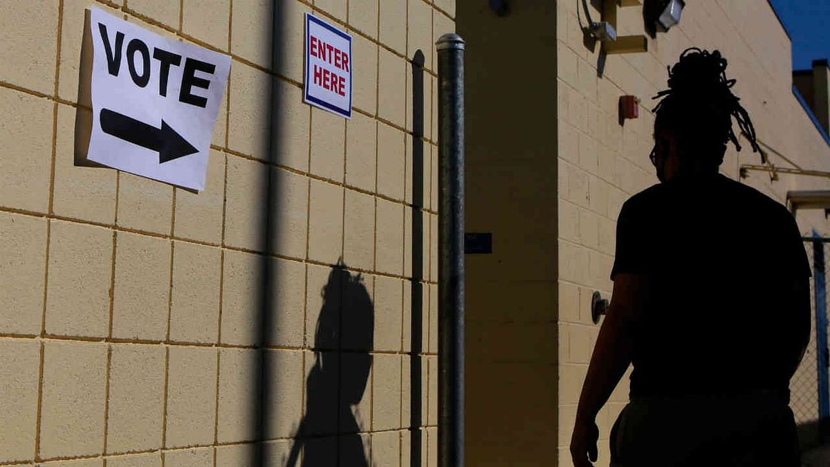 A woman enters a voting station on Election Day at Robert E. Lake Elementary School November 3, 2020, in Las Vegas