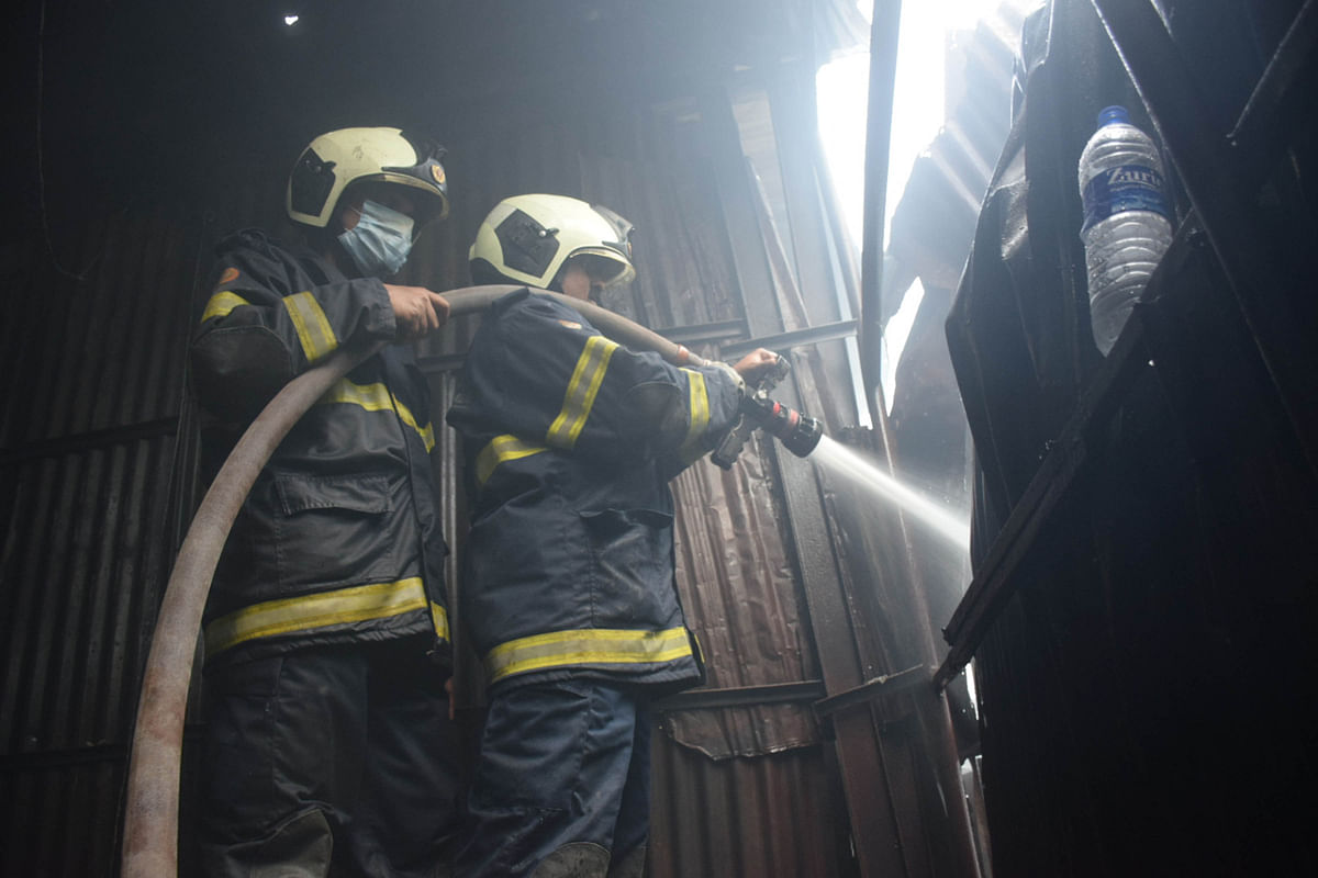 Firefighter in action as fire breaks out at Sakinaka in Andheri on Tuesday