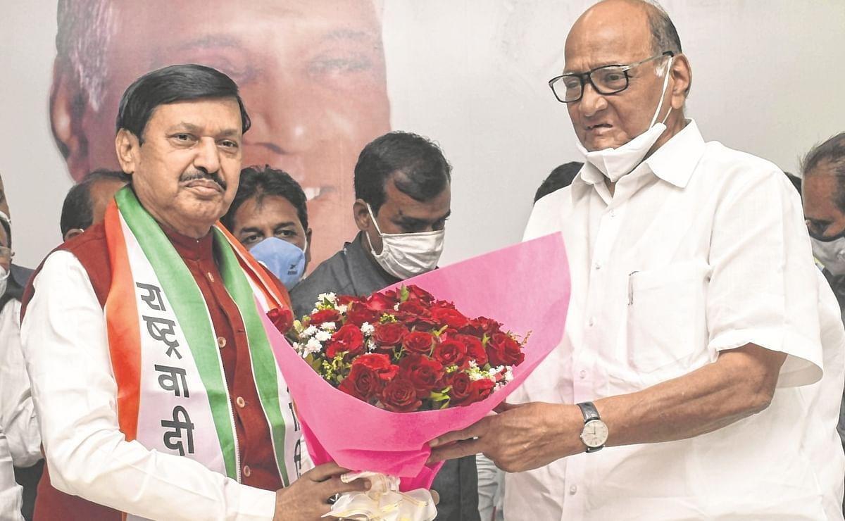 NCPchief Sharad Pawar welcomes Jaysingrao Gaikwad to his party.