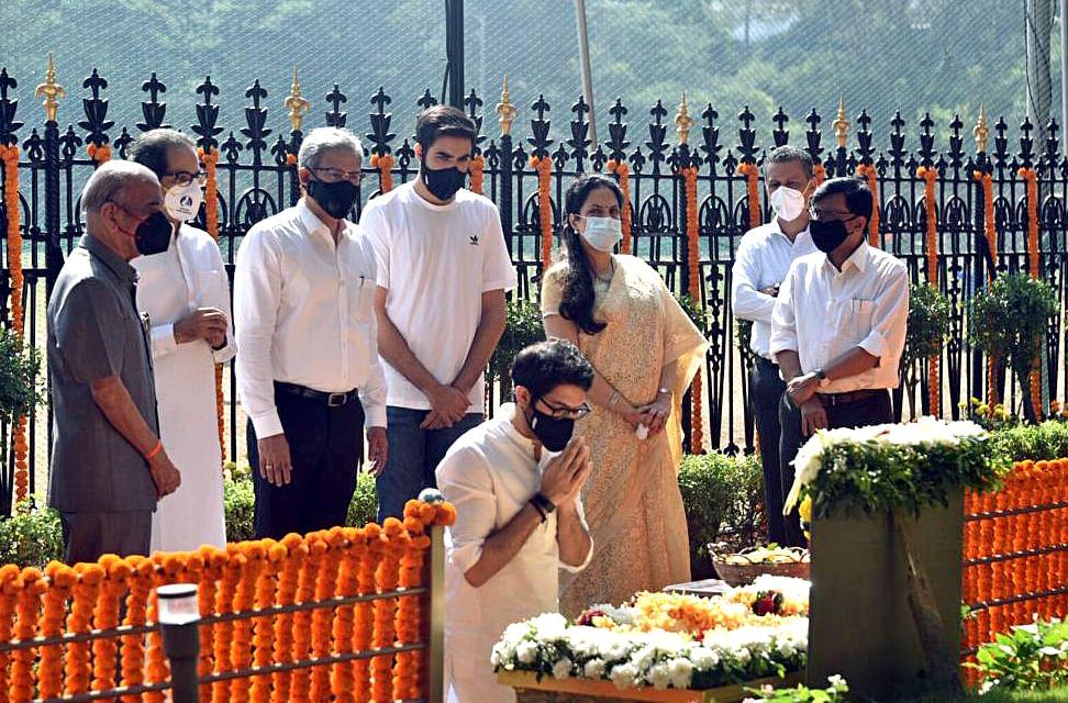 Maharashtra Minister Aaditya Thackeray pays floral tribute to his grandfather BalasahebThackeray at his Memorial on his death anniversary, at Shivaji Park in Mumbai on Tuesday