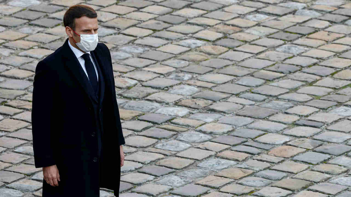 French President Emmanuel Macron arrives to attend an honorary funeral ceremony for World War II resistant Daniel Cordier at the Hotel des Invalides in Paris on November 26, 2020