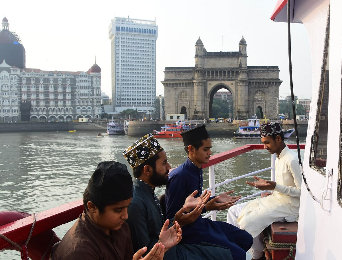 Mumbai: Boat owners pray as they start ferry service from Gateway of India to Alibag and Elephanta, with 50% seat-capacity