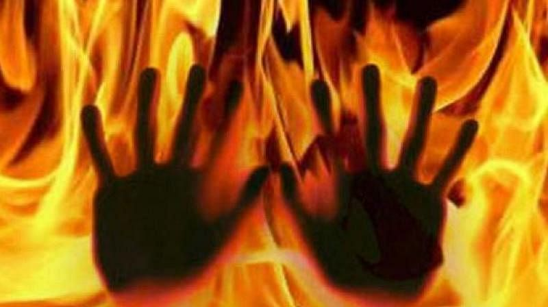 Man sets in-laws' house on fire, held