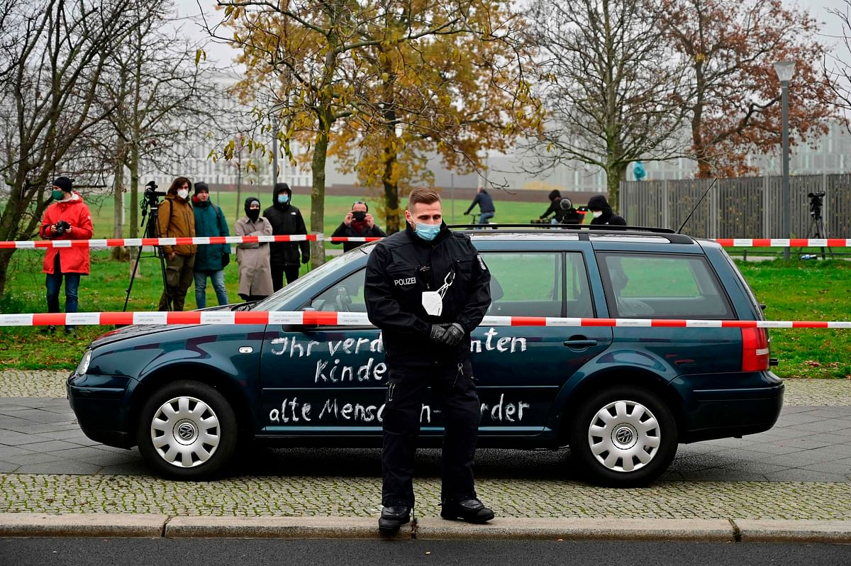 Car with slogans scrawled on sides crashes into Merkel's office