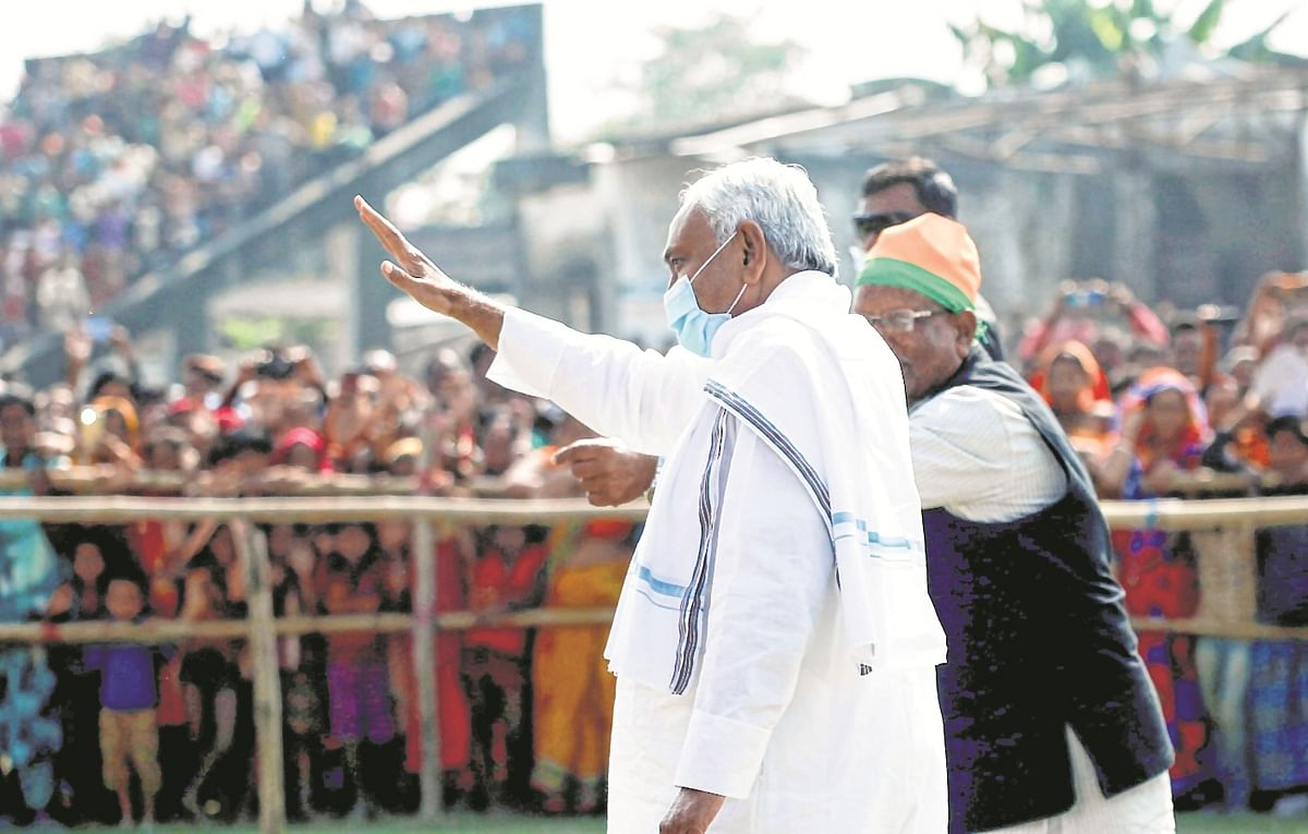 Bihar Chief Minister Nitish Kumar waves to his supporters as he arrives to address an election rally in Katihar on Thursday.