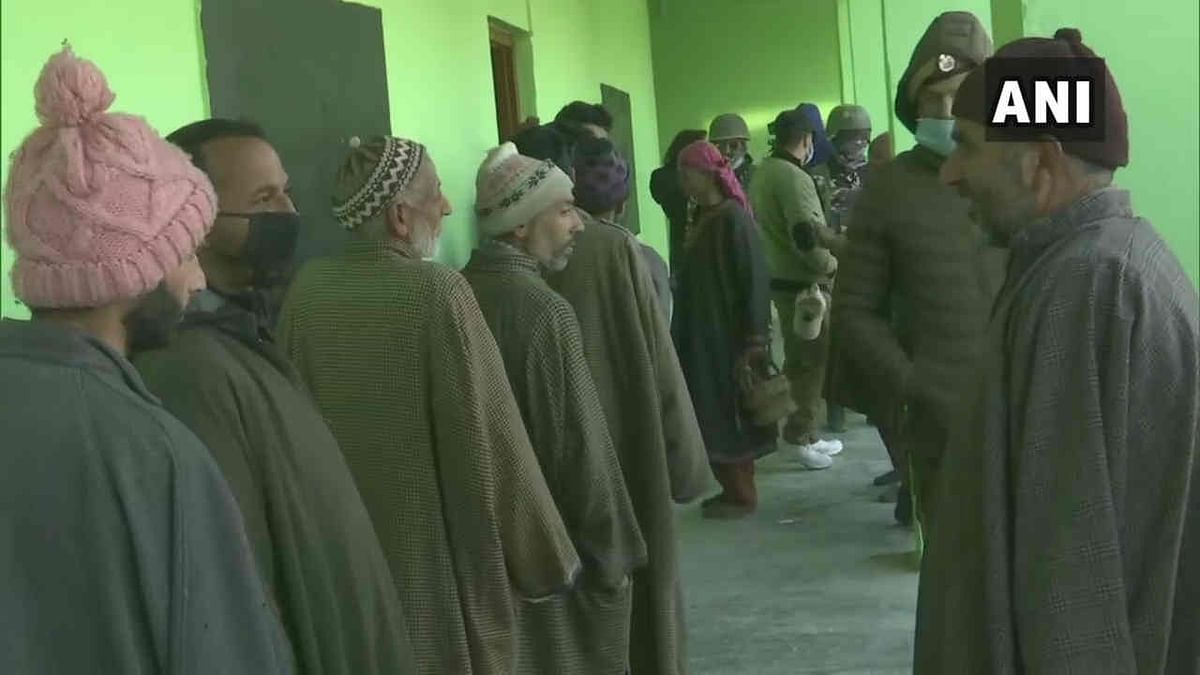 J&K DDC Polls: Face mask, social distancing rules flouted as long queues seen outside polling booths