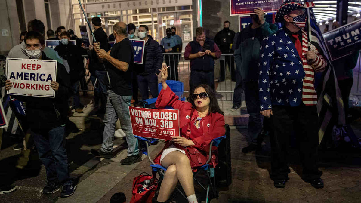 Supporters of U.S. president Donald Trump hold signs and chant slogans during a protest outside the Philadelphia Convention center as votes continue to be counted following the 2020 U.S. presidential election on November 5
