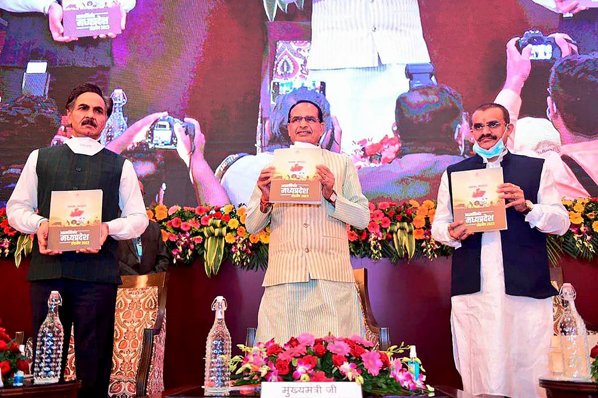 Madhya Pradesh Chief Minister Shivraj Singh Chouhan releases a publication during the launch of the road map to Aatma Nirbhar Madhya Pradesh-2023, in Bhopal.
