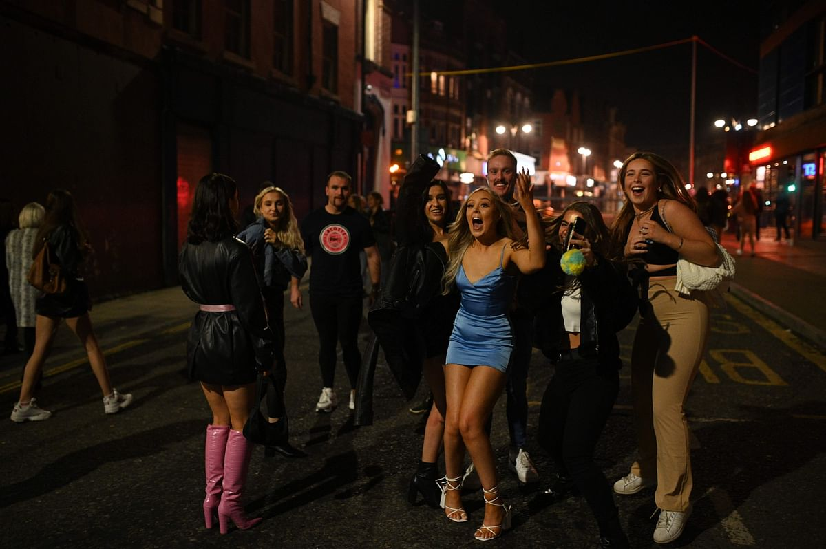 Revellers enjoy outside pubs on the eve of a second COVID-19 lockdown in England