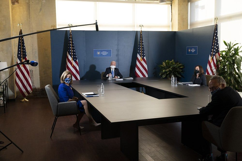 President-elect Joe Biden, speaks during a meeting with Vice President-elect Kamala Harris, right, Senate Minority Leader Chuck Schumer of N.Y and House Speaker Nancy Pelosi in Wilmington.