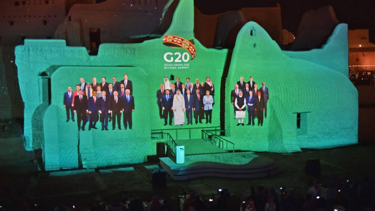 A family photo of G20 Leaders is projected at the historic site of al-Tarif in Diriyah district, on the outskirts of Saudi capital Riyadh, ahead of G20 virtual summit on November 20, 2020.