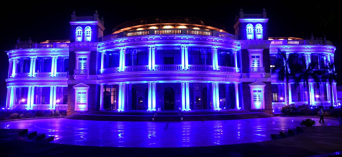 Minto Hall illuminated with blue lights on the eve of the World Children's Day on Thursday