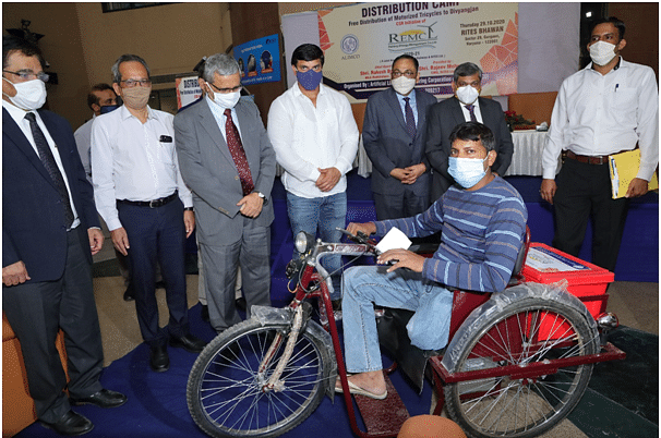 Railway Energy Management Company Limited distributes motorised tricycles among divyangs
