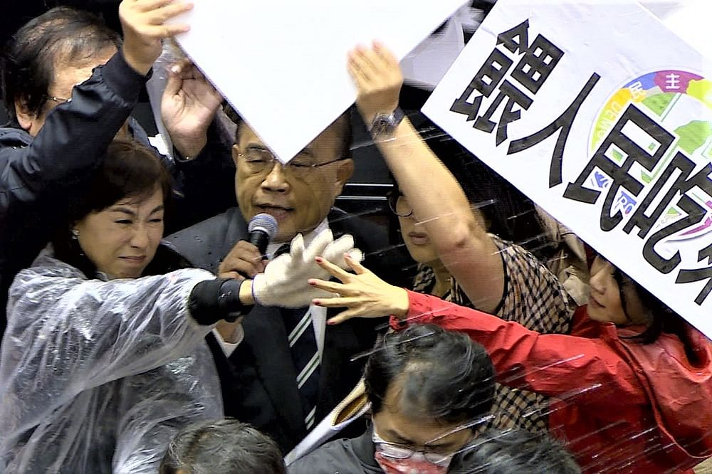 Nasty fight: Punches & flying pig guts in Taiwan parliament