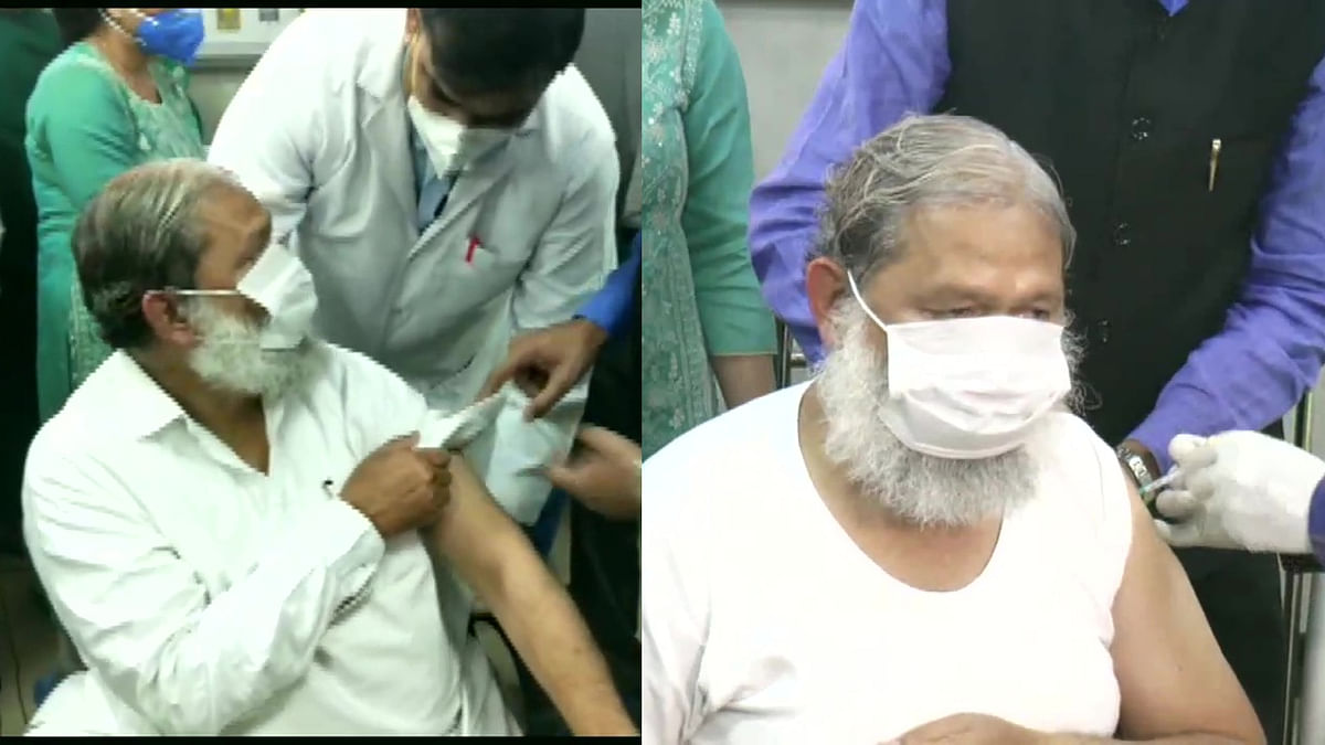 Haryana Health Minister Anil Vij being administered a trial dose of Covaxin, at a hospital in Ambala.
