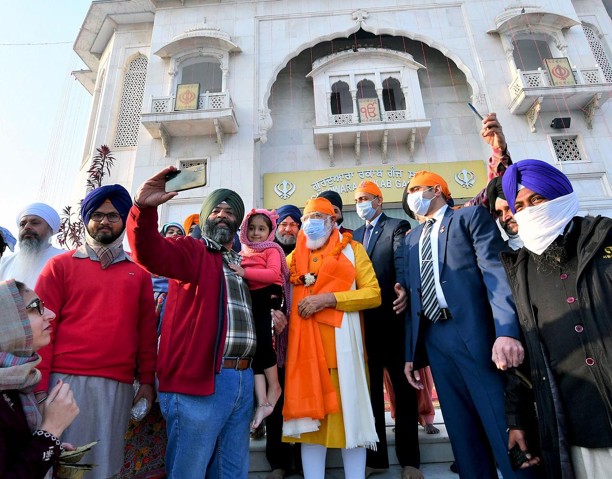 People click a selfie with Prime Minister Narendra Modi as he visits Gurudwara Rakab Ganj Sahib on the occasion of the 400th Prakash Parv of Guru Teg Bahadur, in New Delhi on Sunday.