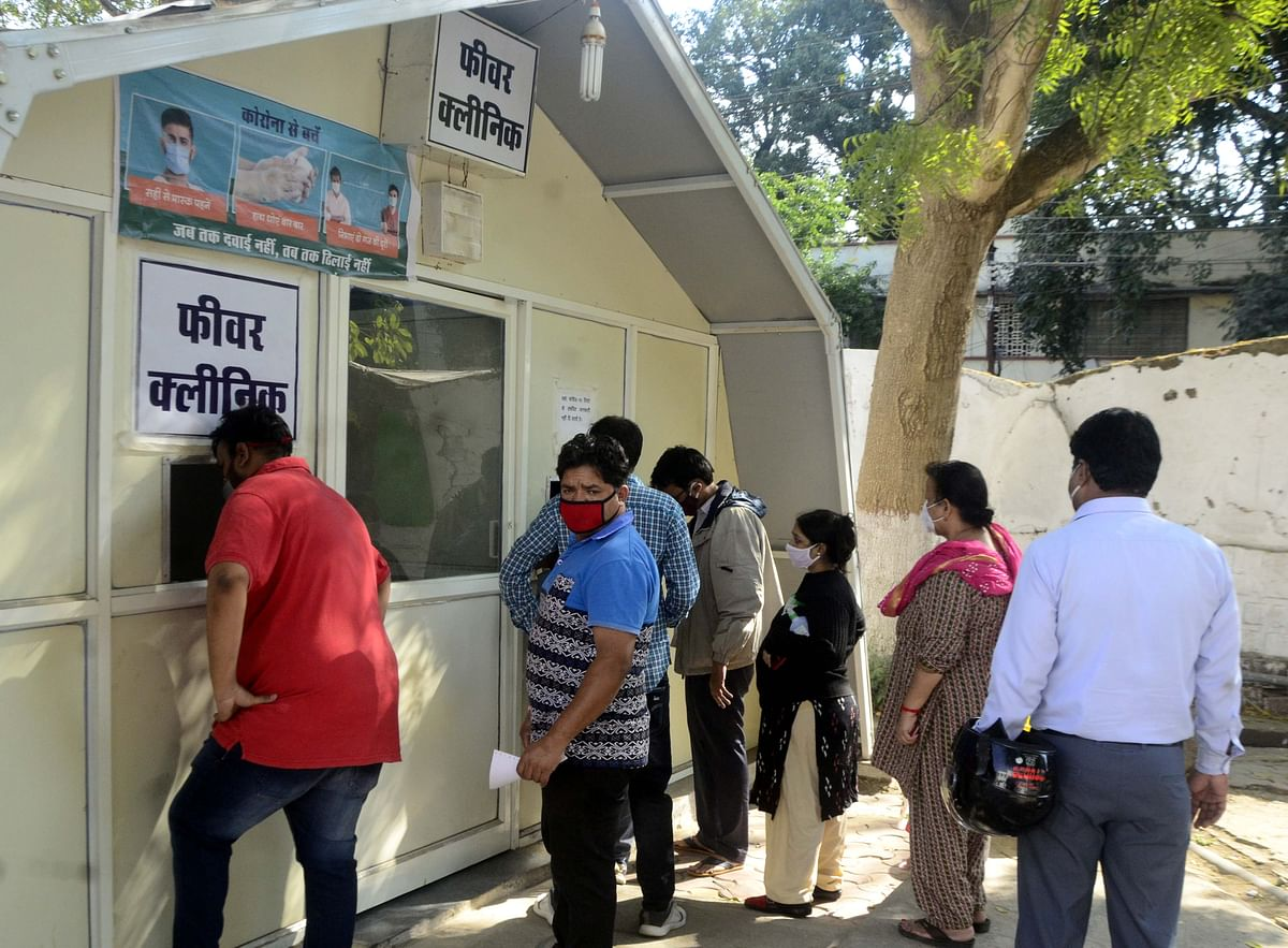 People queue up at fever clinic in Bhopal on Thursday