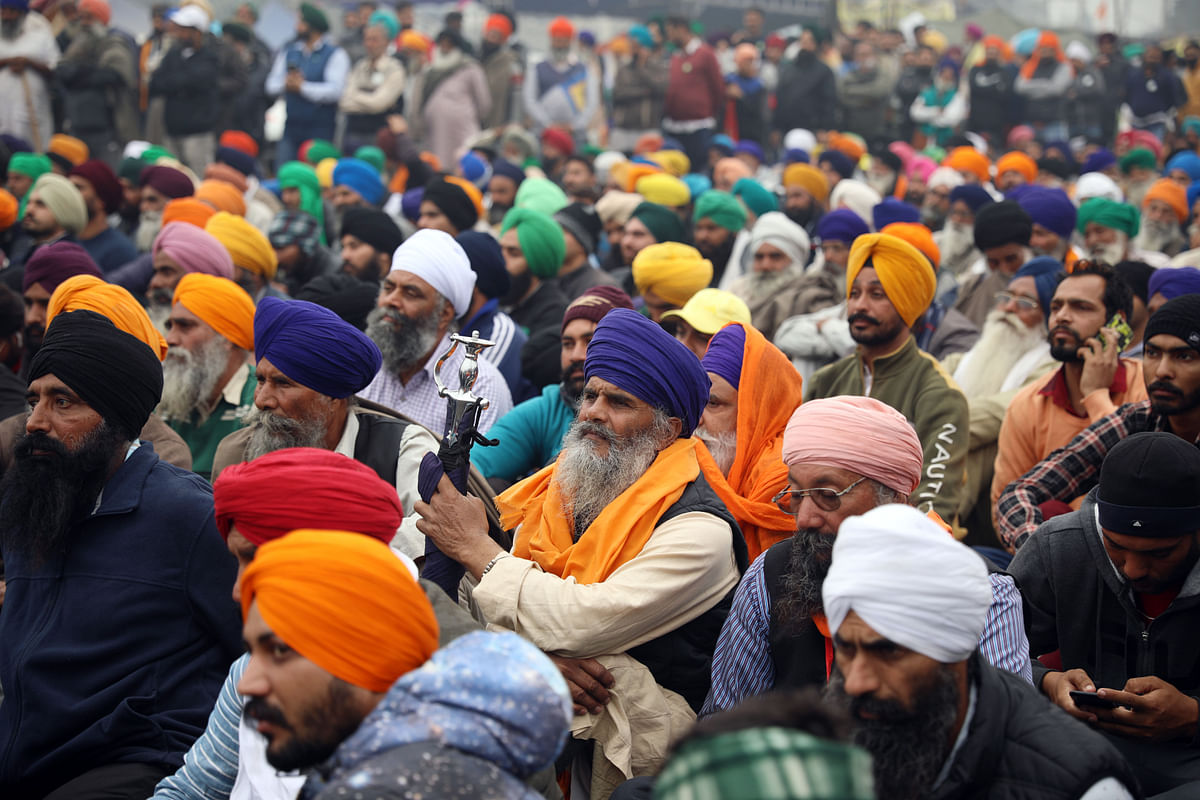 Farmers sitting at Singhu Border during a protest against the newly passed farm law, in New Delhi on Saturday.
