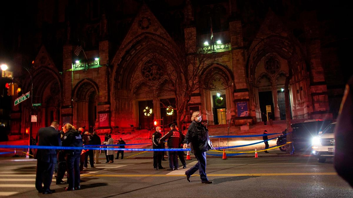 Police officers stand guard outside of the Cathedral of St. John the Divine in New York on December 13, 2020, after a shooter opened fire outside the church.