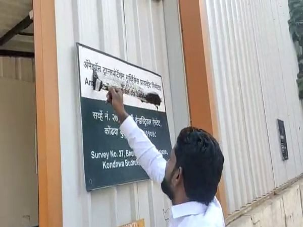 Attacker defacing sign at Amazon warehouse in Pune last week