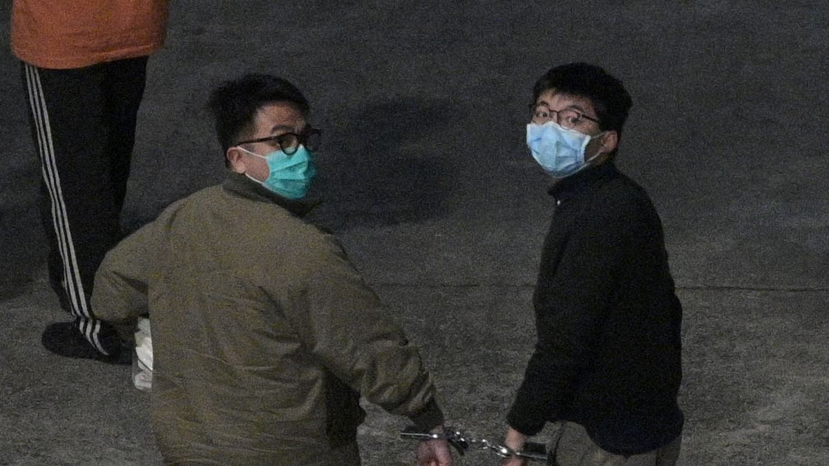 Activists Joshua Wong (R) and Ivan Lam (L) arrive at Lai Chi Kok Reception Centre in Hong Kong on December 2, 2020 after being sentenced