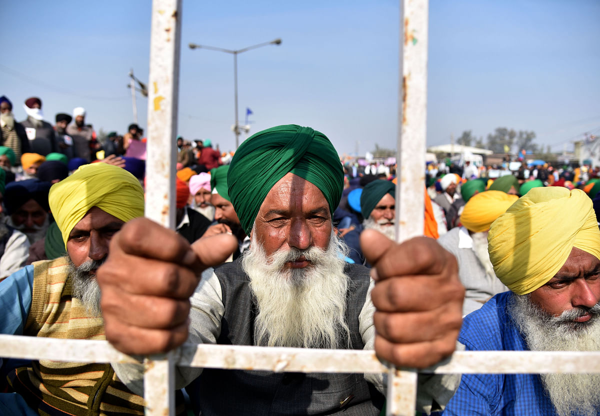 New Delhi, Dec 20 (ANI): Farmers during their ongoing protest against Farm bills at Singhu Border, in Delhi on Sunday.
