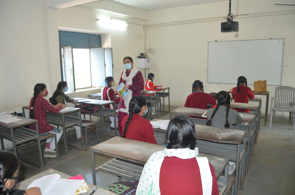Students attending class maintaining social distancing