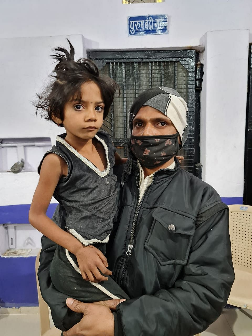 Father and rescued daughter