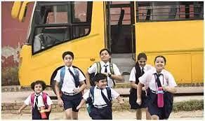 Schoolchildren near their bus