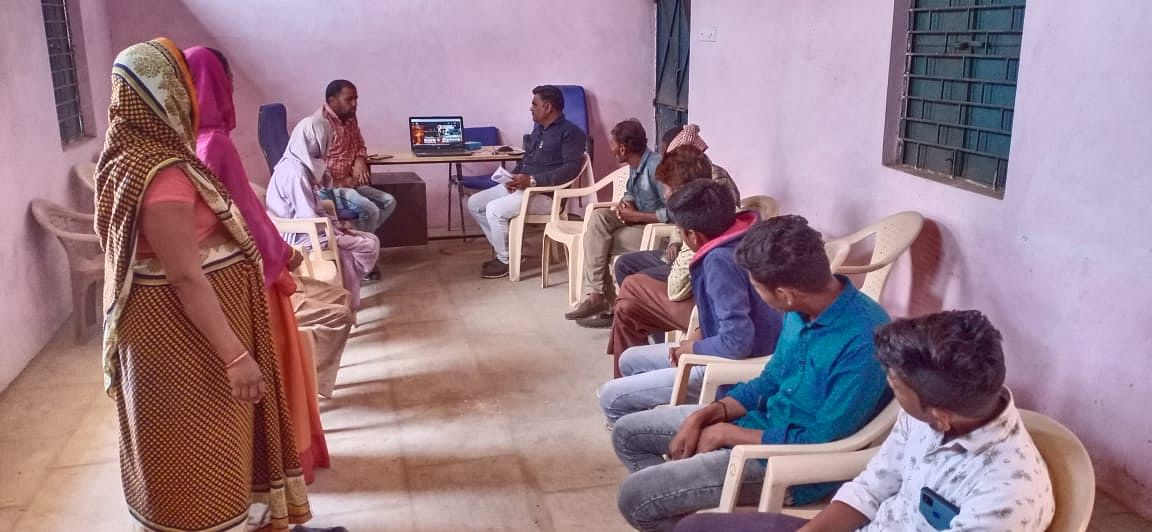Villagers listening listening Prime Minister Narendra Modi through video-conferencing