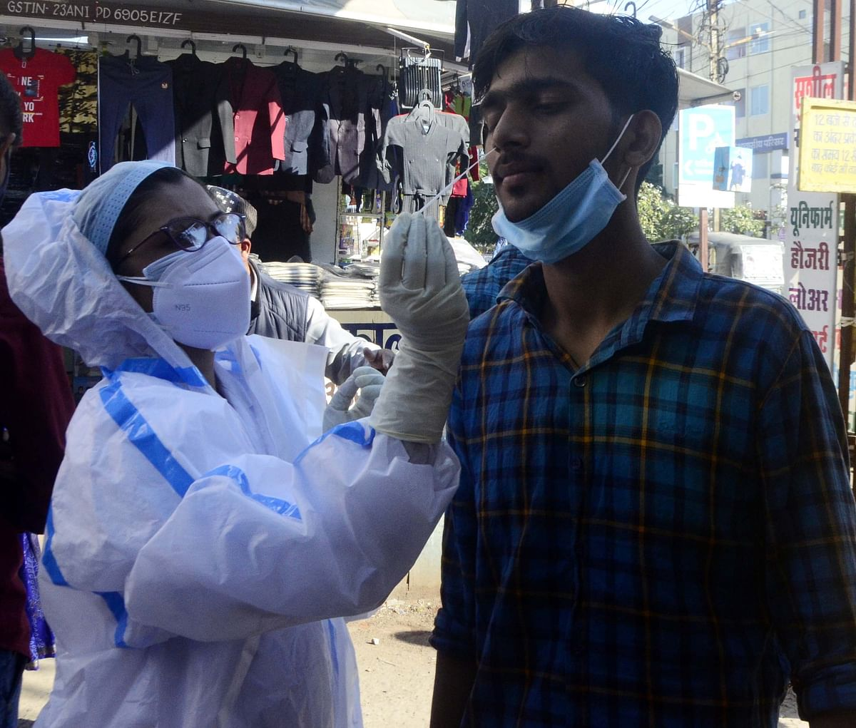 Health worker takes sample