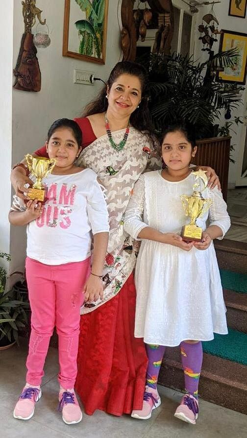 Devyani Bharadwaj (on right) who was first runner-up in the International Spell Bee (Junior) contest with her mother Smita Bharadwaj and twin sister Shivranjani Bharadwaj, who came in second in the national round of the competition